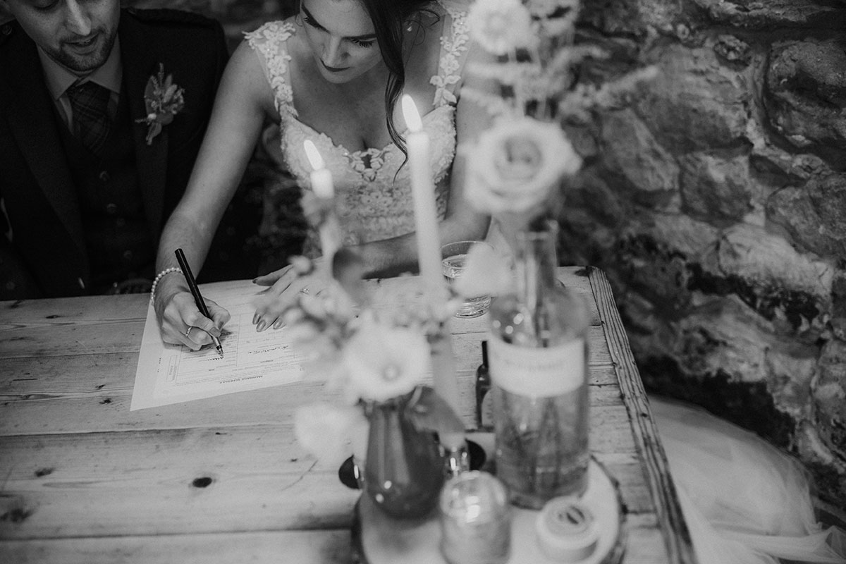 bride and groom signing register after ceremony at fruin farm
