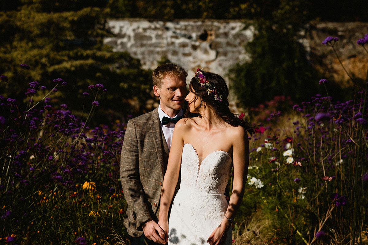bride and groom in walled garden at Cambo Estate