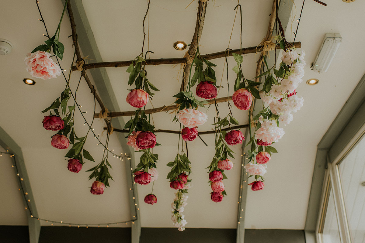 pink roses hanging from ceiling at wedding at fruin farm