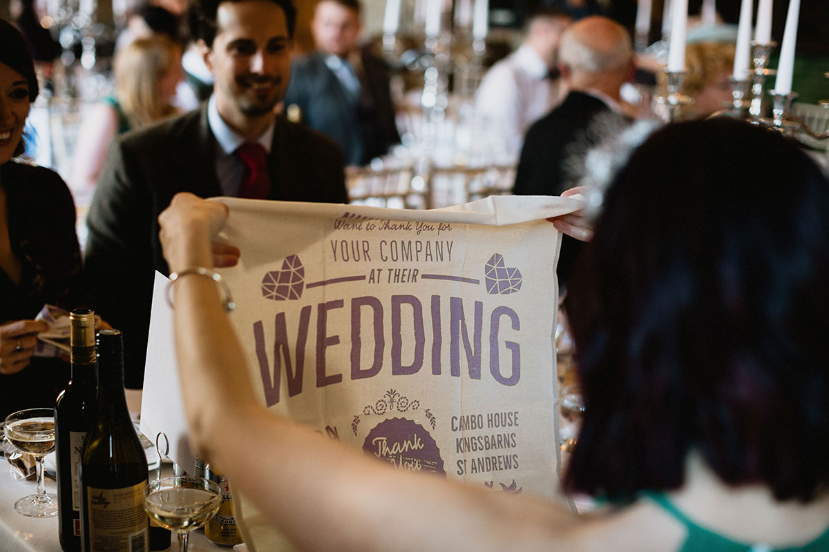 guest opening wedding tea towel favour