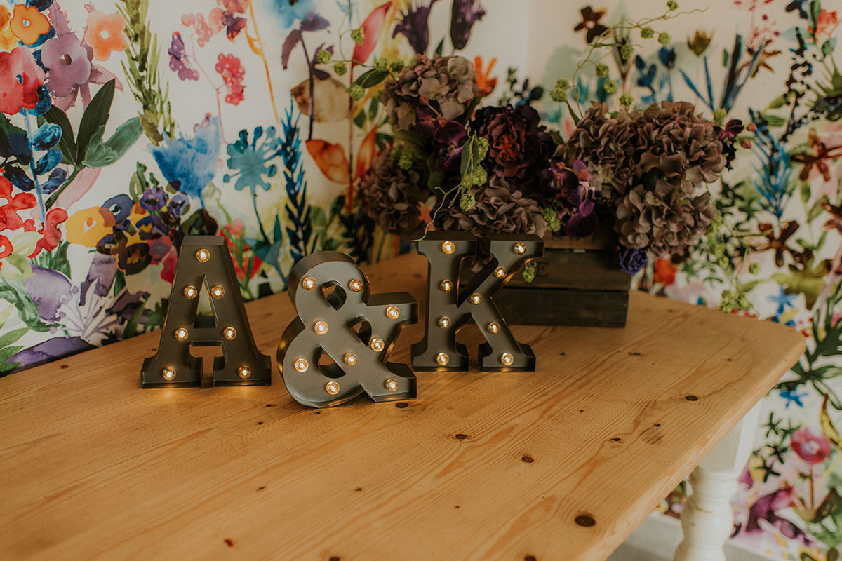 illuminated initial letters sitting on wooden desk