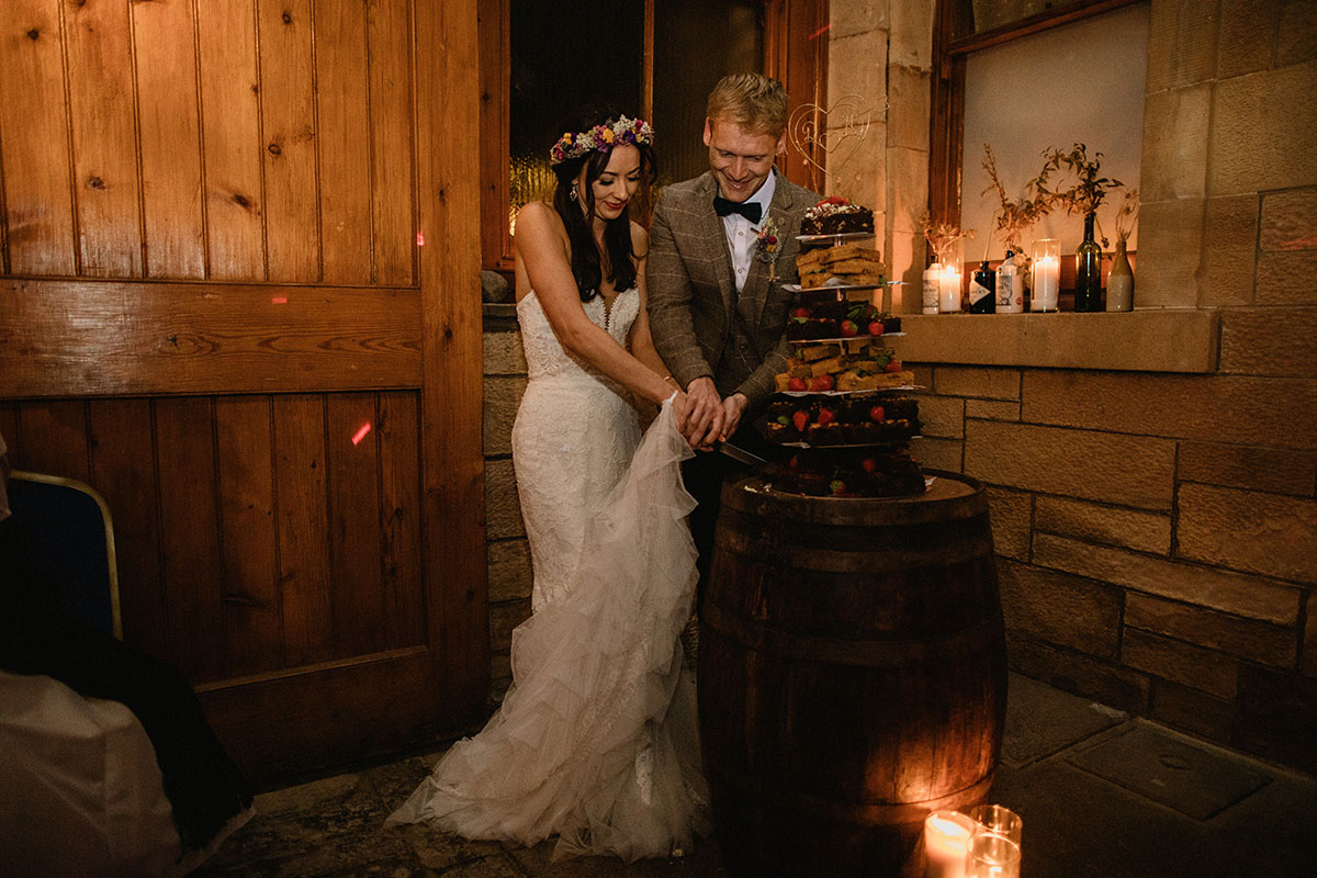 bride and groom cutting brownie stack