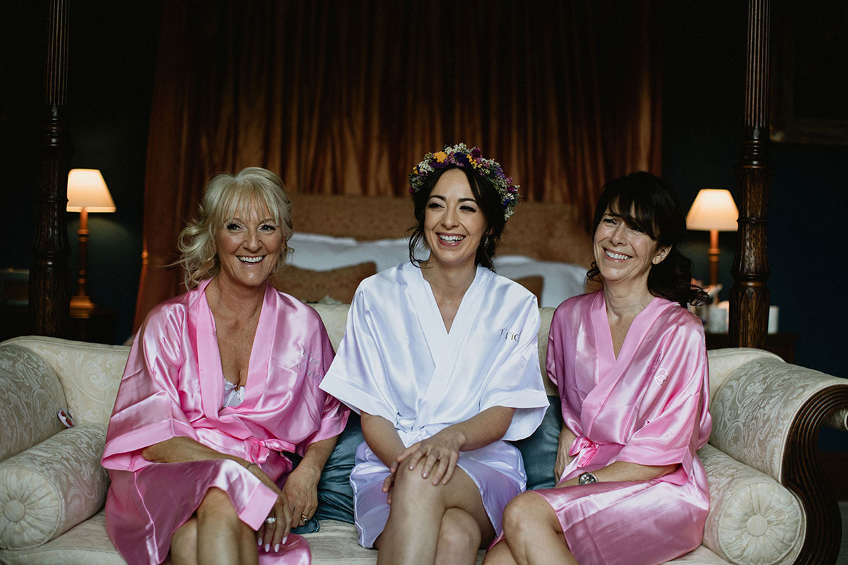 bride, bridesmaid and mum wearing pink and white robes on wedding morning at Cambo House