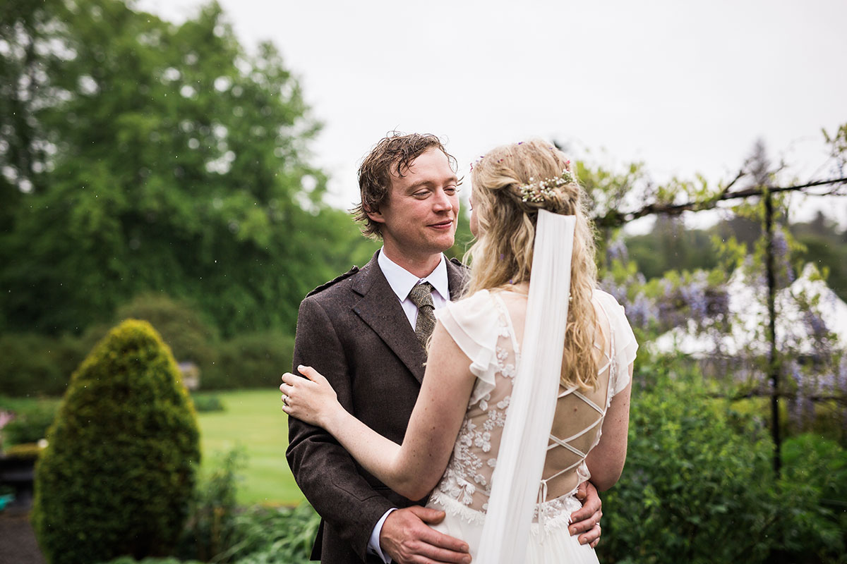bride and groom in garden at Murthly Castle