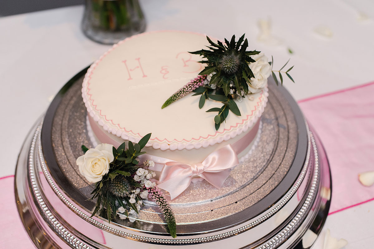 small personalised pink wedding cake from Harry Gow Inverness