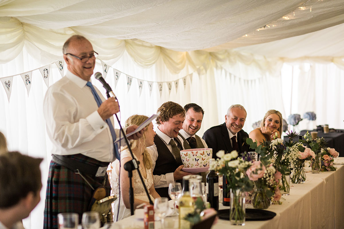 man wearing glasses making speech at a wedding in a marquee at Murthly Castle in Perthshire