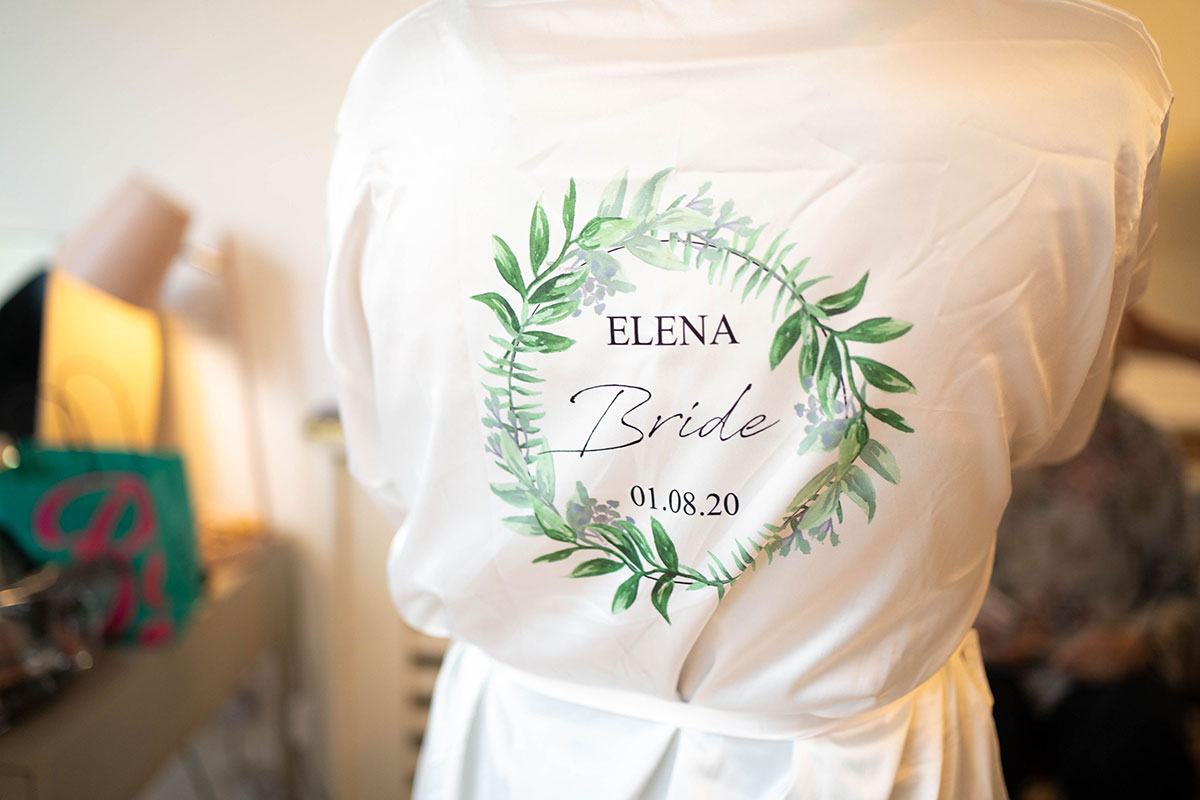 back of bride wearing personalised dressing robe with circular leaf illustration on back
