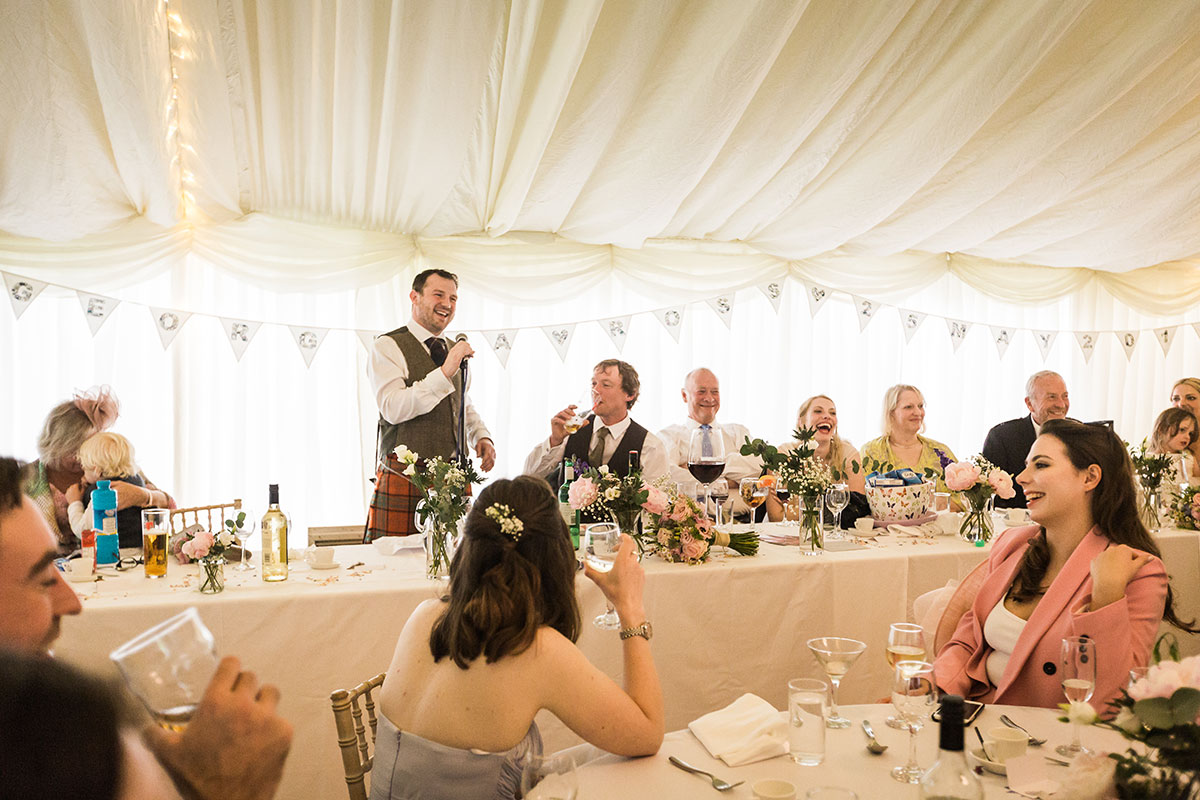 best man doing wedding speech in marquee at Murthly Castle