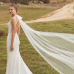 Model wearing Aura wedding dress by Rosa Clara Boheme from Kudos Bridal Boutique in Edinburgh