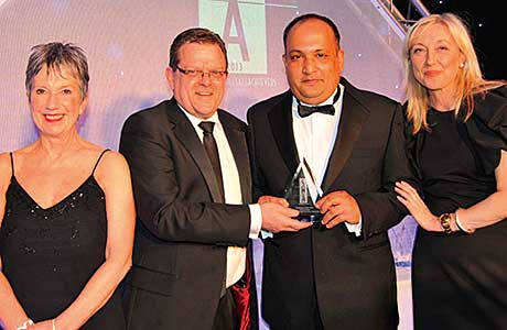 The Employee of  the Year Award won by Abhay Singh, United Wholesale Grocers, Polmadie and sponsored by Premier Foods. From left to right: Kate Salmon; Ross Brown, business manager, Premier Foods; Abhay Singh, floor supervisor at United Wholesale Grocers, Polmadie; and Cathy Macdonald.