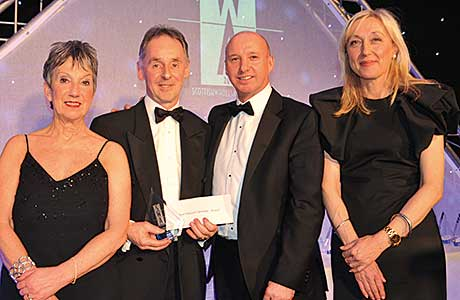 Andy Stevens, head of sales UK, JTI for the presentation of the Best Delivered Operation (Retail) Award.