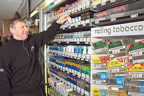 Dennis Williams at the tobacco gantry at Broadway Convenience Store in Oxgangs in Edinburgh. Troops returning from Afghanistan boosted sales of Lambert & Butler. RYO brands are doing well. And the store's till system includes full age-restricted product prompts.