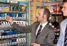 Tim Oates of Imperial Tobacco, left, and Grant MacBean, manger of Lomond Service Station in Jamestown, Alexandria, close to Loch Lomond, discuss the store's tobacco range.