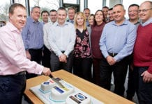 Colin McLean, chief operating officer of Scotmid Co-operative cuts the 100th bakery cake watched by Stephen Brown, bakery and local sourcing manager, second left and operations, support and regional business managers.