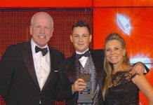 Andrew Helm, key account manager for British American Tobacco, left, and sports TV personality Georgie Thompson, right, present the Scottish Grocer 2014 Employee of the Year Award to Marc McCabe.