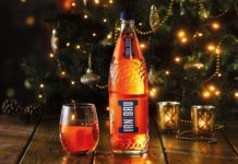 Irn Bru in front of a Christmas tree