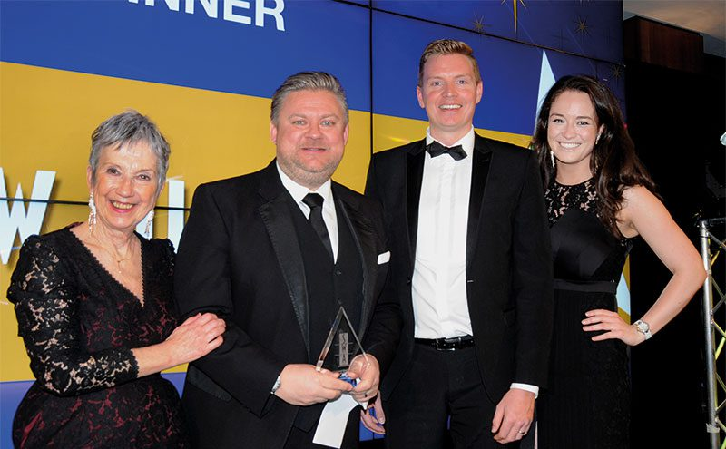 Lawrence Williamson, senior national account manager at Halewood International, presents Best Delivered Operation (Retail) to Simon Hannah, MD of JW Filshill with Kate Salmon, left, executive director, SWA and host Jennifer Reoch of STV, right.