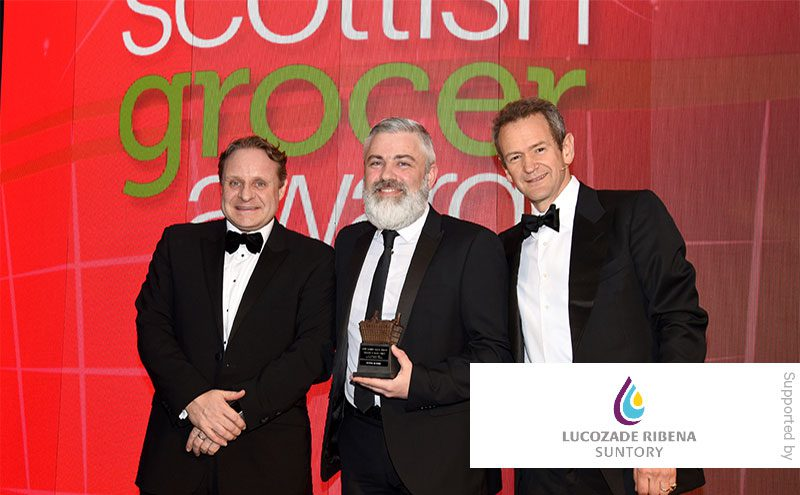 Matthew Gouldsmith, Lucozade Riberna Suntory, and Alexander Armstrong present the Innovation in Impulse Award to Scott Graham, McLeish, Inverurie.