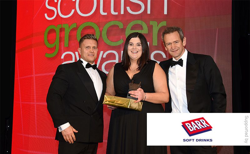 Mark Taylor, sales development manager at Barr Soft Drinks, and Alexander Armstrong present the Best New Store award to Samantha Stalker, Spar Halbeath.