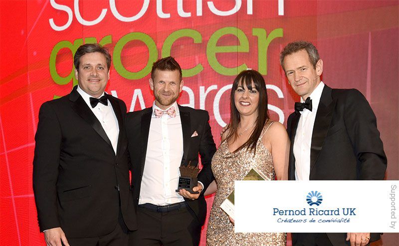 James Middleton, field sales director at Pernod Ricard UK and Alexander Armstrong present the Licensed Retailer of the Year award to Ross Macpherson and Mandi Duncan, Doonfoot Day-Today, Ayr.