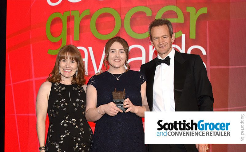 Scottish Grocer group advertising manager Emily Sanderson and Alexander Armstrong present the Employee of the Year award to Sasha Henderson, David's Kitchen, Falkirk.
