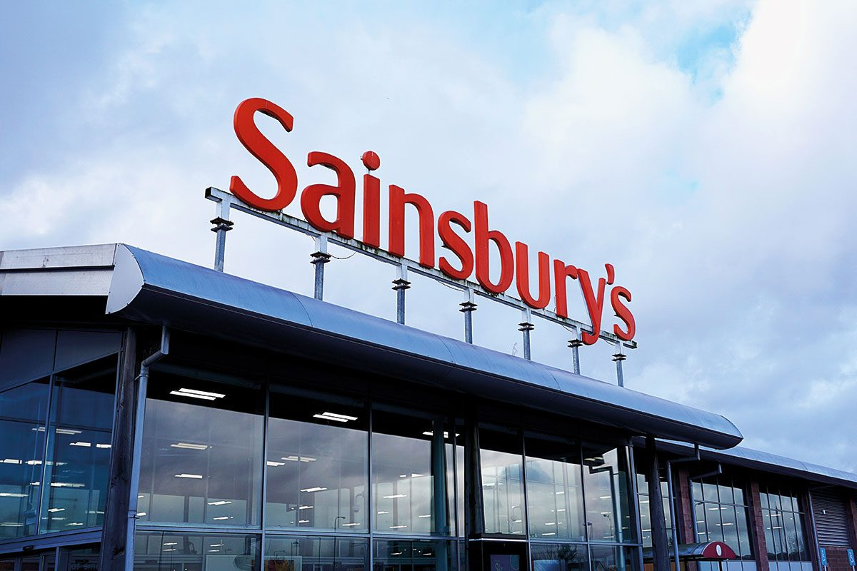 Orange Sainsbury Sign Over Supermarket
