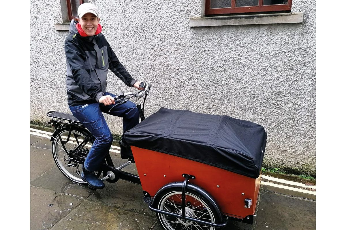 Business-owner,-Karin-Jonsson-delivering-products-on-her-Babboe-Cargobike