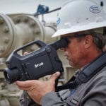 man-holding-camcorder-on-site
