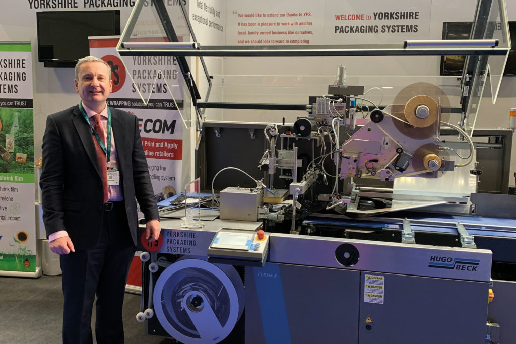 Glyn infront of stall with machinery