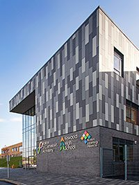 FIBRE cement panels in three colours of grey allowed the architect for an education complex to emulate the appearance of stone or slate bands.