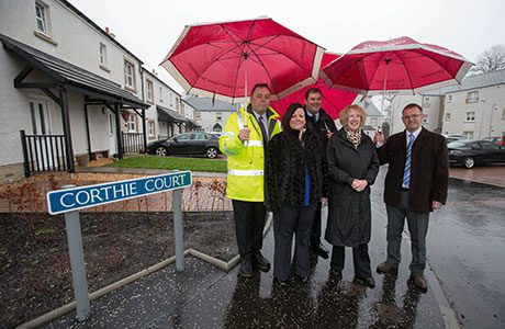 Steve Bentley, Falkirk Council, tenant Laura Ross, Peter Shepherd from Mactaggart & Mickel Group, Margaret Burgess MSP and Neil Rutherford from Scottish Futures Trust.