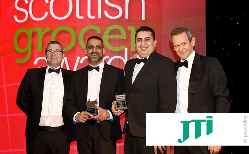 Stephen Donaghy, area sales manager JTI, and Alexander Armstrong present The Entrepreneur Award to Sayiad Hamid (second from left) and Imran Ali, Bourtreehill Supermarket.