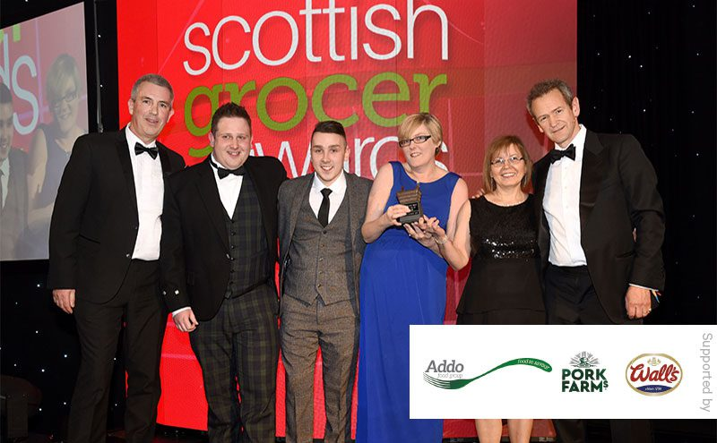 Mark Allman, impulse national account manager, Addo Food Group and Alexander Armstrong present the Chilled Retailer of the Year award to Pinkie Farm Convenience Store.