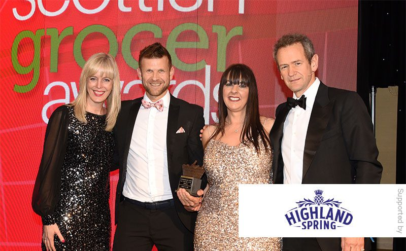Nichola Grant, Highland Spring, and Alexander Armstrong present the Health Promoting Retailer of the Year Award to Doonfoot Day-Today.