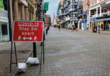 covid sign on high street